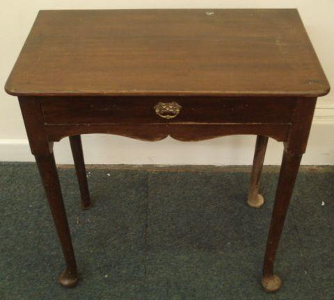 A mid 18th Century mahogany lowboy, the rectangular top above a frieze drawer and undulating apron, on club legs and pad feet, 69cm.