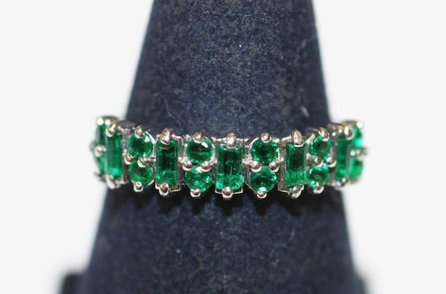 An emerald half hoop ring,