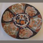 A large Japanese Imari decorated charger, Meiji, circa 1900, centrally decorated with peony within panelled borders of flowers and phoenix, 45cm.