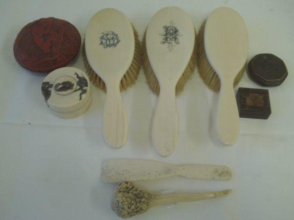 A Japanese turned ivory pot and cover, engraved with elephants, three ivory backed hair brushes, bone shoe horn, a horn lid, a small Tunbridgeware box, Chinese carved red lacquer box and cover, 20th Century and a Japanese mixed metal inlaid octagonal box and cover.