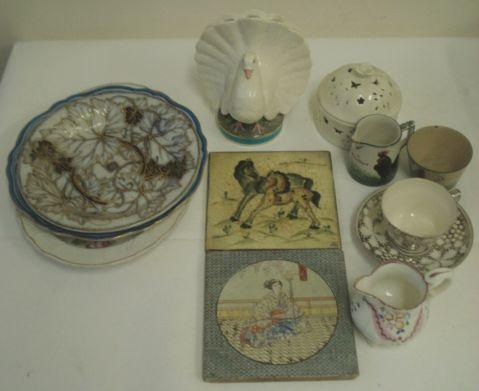 An English novelty flower vase, modelled as a fan tail dove standing on a circular base, Registration mark, 16cm, a Wemyss ware Bon Jour jug and basin, a creamware style pot and cover a Derby style oval silver shape dish painted with flowers, leaf moulded dish, two pottery tiles silver lustre cup and saucer cream jug, and a porcelain plate painted, crested and monogrammed shield within blue painted border.