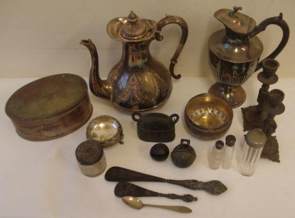 A celadon shaped salt, with flower head decoration, on shell capped hoof feet makers mark, only 'I. H.' an Indo/Burmese circular bowl, small cut glass perfume bottle with screw cover, a Dutch silver teaspoon, a pair of cast bronze figural candlesticks, 16cm, plated items, two small crotal bells, dressing table jars, shoe horn, button hook, and other items.