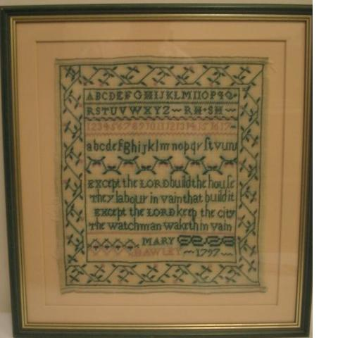 A 19th Century cross stitch sampler, by Anne Otton, 1863, worked with alphabet, numbers and stylised flowers, 31 x 30cm, another by Mary Mawley 1797, worked with alphabet, numbers, rhyme within meandering floral border (washed), 31 x 27cm, a miniature sampler by M Pells February 1835, worked with alphabet, numbers, trees and animals, 7.5 x 7.5cm, together with a woolwork picture in wooden veneered frame, 31 x 26cm.