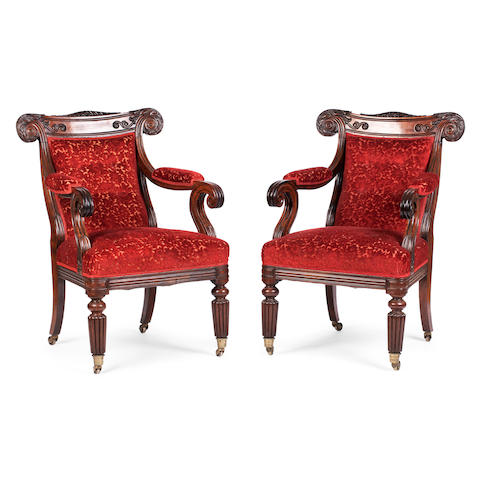 A pair of 19th century solid rosewood library armchairs probably Anglo-Indian, second quarter 19th century
