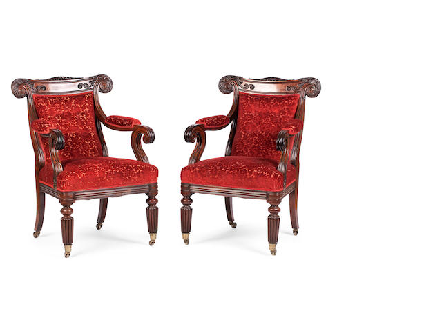 A pair of Anglo-Indian solid rosewood library armchairs second quarter 19th century