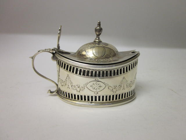 A George III oval mustard pot maker P C untraced,  London 1787,