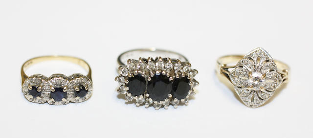 Two sapphire and diamond cluster rings and a diamond panel ring, (3)