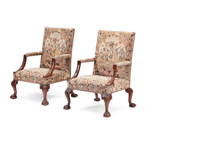 A pair of George II style mahogany open armchairs probably second quarter 20th century