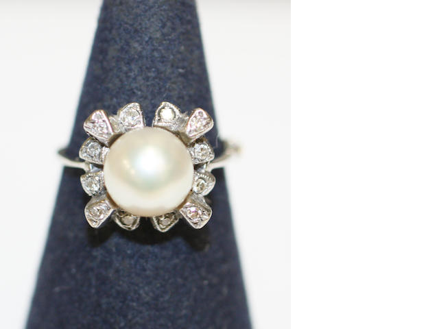 An 18ct white gold cultured pearl and diamond dress ring