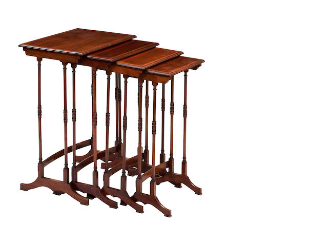 A 19th century quartetto set of mahogany and satinwood-banded tables