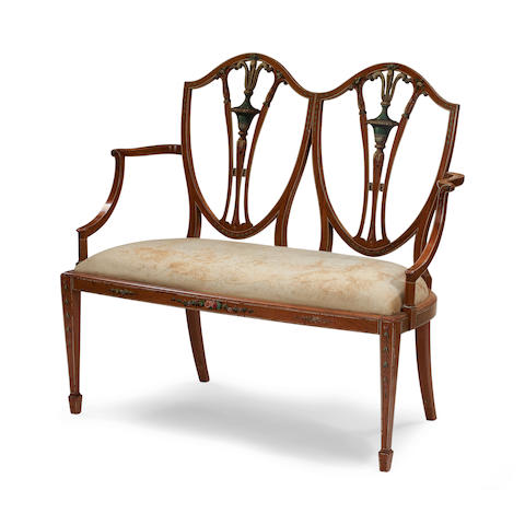 A late Victorian satinwood painted chair back settee In the manner Wright and Mansfield