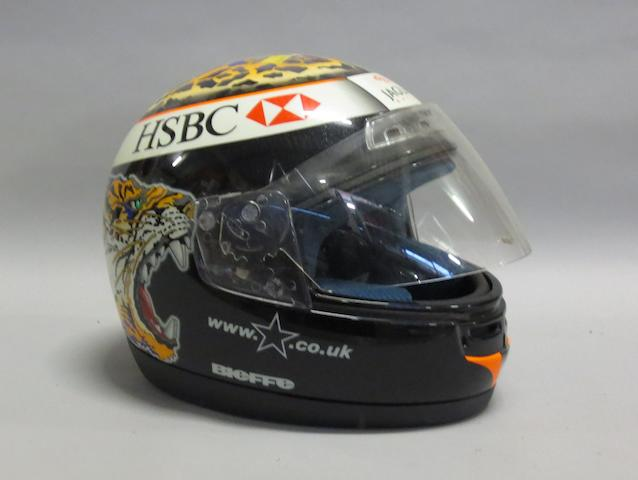 An Eddie Irvine replica racing helmet,