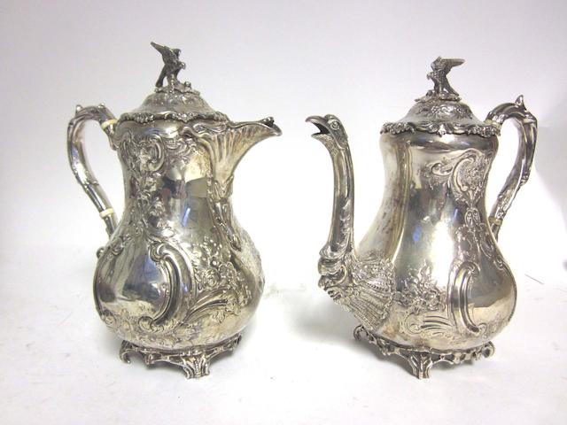A matched Victorian/Edwardian silver coffee and hot water pot the coffee pot by Richard Martin & Ebenezer Hall, Sheffield 1896, the hot water pot by Goldsmiths & Silversmiths Co Ltd, London 1910; together with four assorted bon bon dishes (6)