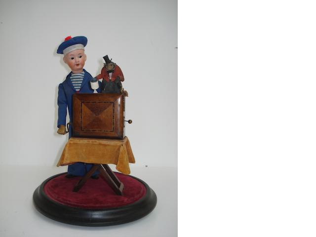 A boy organ grinder and begging monkey musical automaton,  circa 1910 and later,