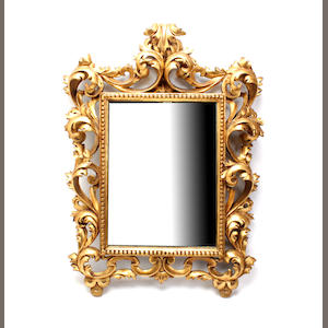 A Florentine giltwood mirrorlate 19th/early 20th century,