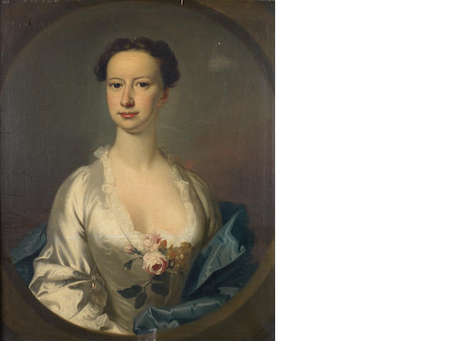 Circle of Allan Ramsay (Edinburgh 1713-1784 Dover) Portrait of Lettice Berridge, bust-length, in a white silk dress, embellished by a flower posy, within a painted oval