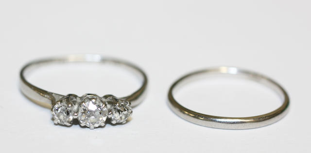A diamond three stone ring and a wedding band, (2)