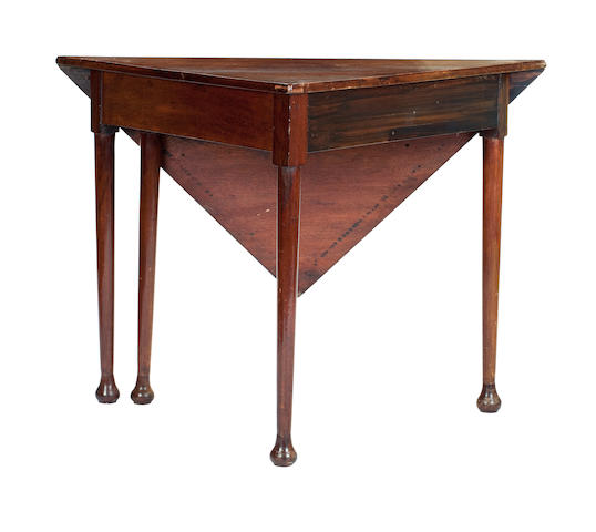 A 19th century mahogany drop-flap corner table