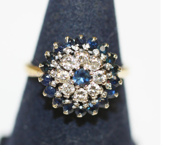 An 18ct gold sapphire and diamond target cluster ring,