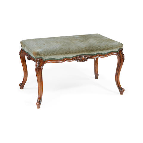 An early Victorian walnut stool in the Louis XV revival style