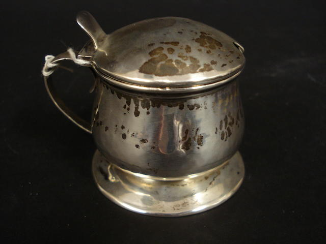 A silver mustard pot by Liberty