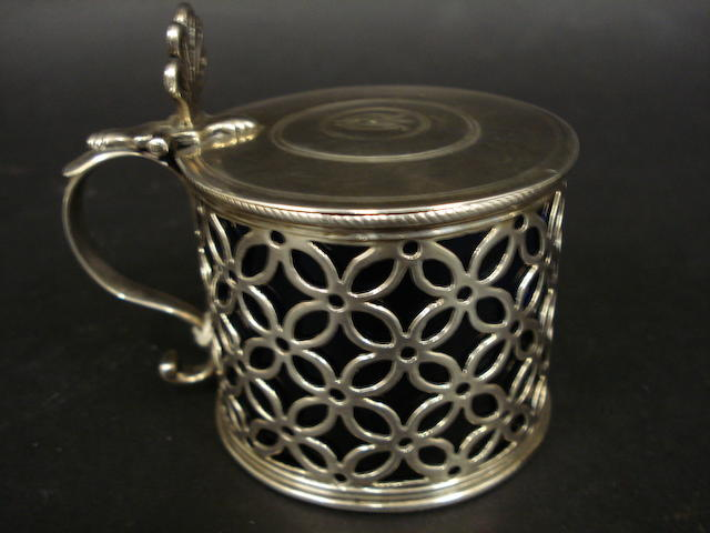 A George III silver pierced mustard pot by WL, untraced, see 3893, Grimwade, London 1765