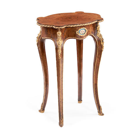 A late 19th century figured walnut, gilt metal and porcelain mounted occasional table  in the Louis XV style
