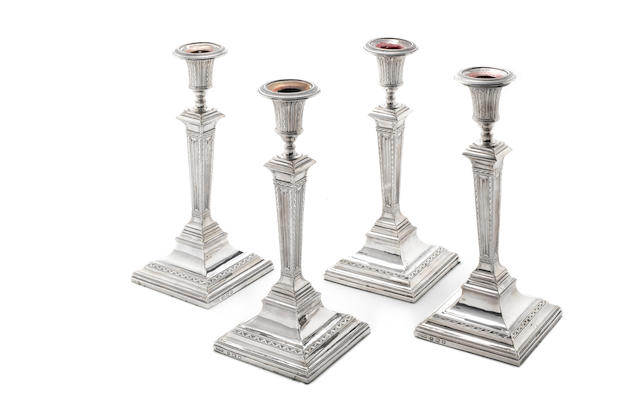 Four George III  silver candlesticks by John Winter & Co with London town mark overstriking that for Sheffield, 1782  (4)