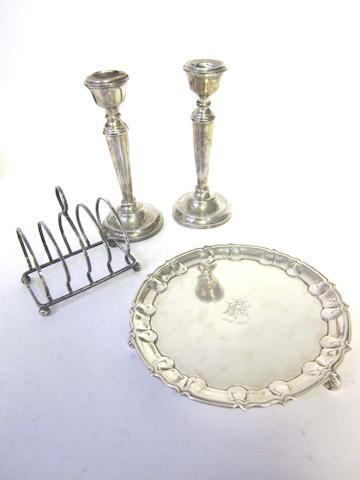 A pierced  silver fruit dish by Adie Bros Ltd Birmingham 1948; together with a small salver, a waiter, a pair of candlesticks and a toast-rack  (6)