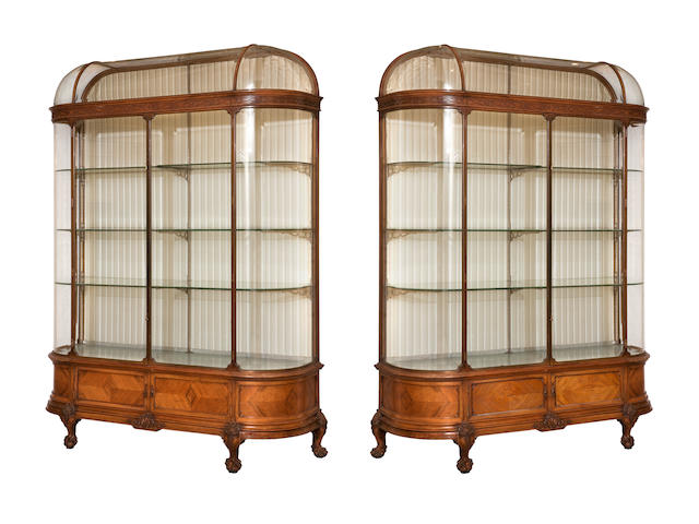 An impressive pair of walnut, bronze and bevelled glass showcasesby F. Sage & Company Ltd., first quarter 20th century,