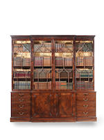 A George III mahogany breakfront library bookcase in the manner of Thomas Chippendale