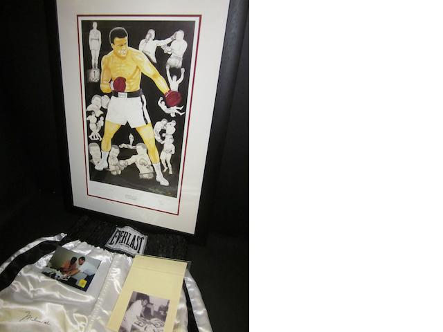 A pair of boxing trunks and a Paddy Monaghan limited edition print, both hand signed by Muhammad Ali