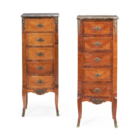 A pair of French late 19th/early 20th century tulipwood tall chests  in the Transitional style