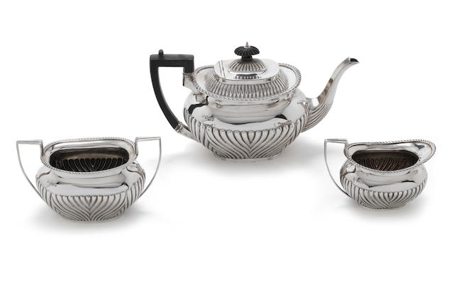 A Victorian silver three-piece tea service by James Deakin & Sons,  Sheffield 1896  (3)