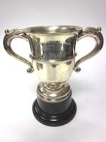A modern silver two-handled trophy cup by Alfred James How, London 1922; together with two smaller examples