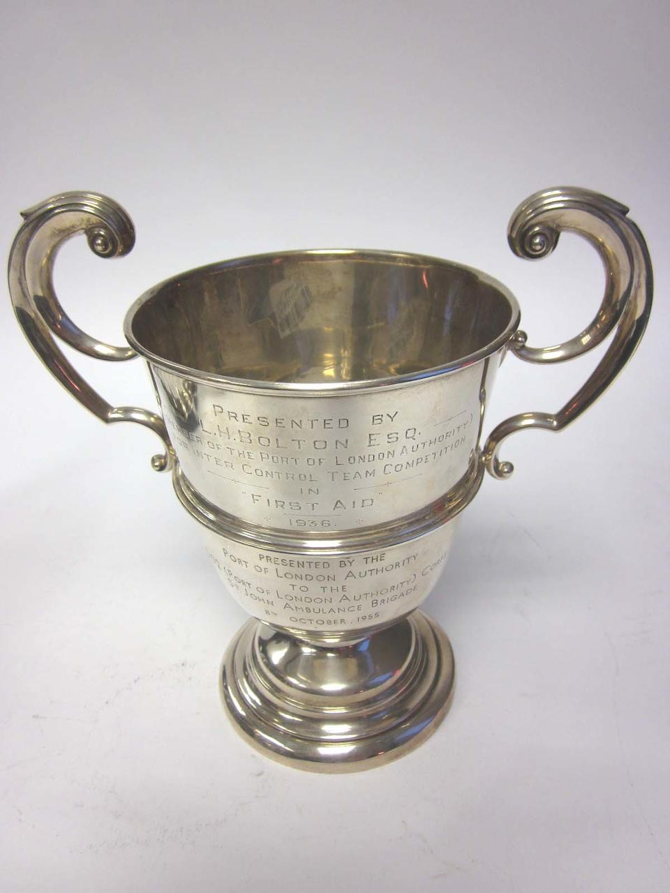 A 20th century silver presentation cup by Alfred James How, London 1930; together with three two-handled presentation cups  (4)
