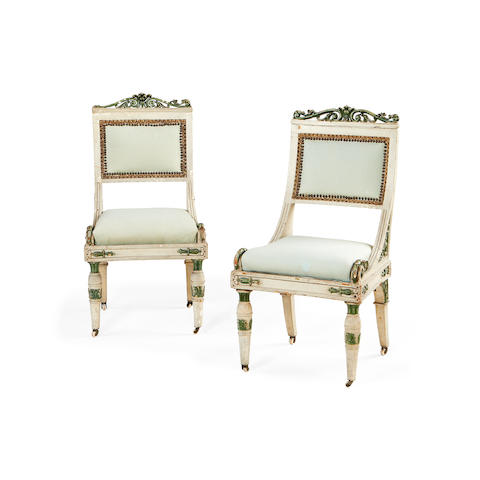 A set of four North Italian second quarter 19th century cream and green painted side chairs