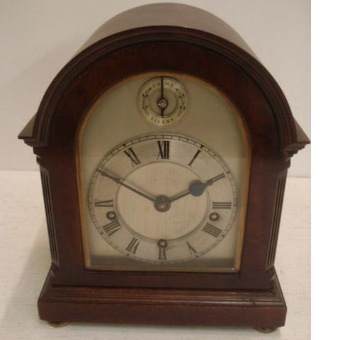"A late 19th century mahogany mantel clock, the 5"" silvered broken arch dial with Roman chapter and strike/silent to chiming movement in mahogany case, 26.5cm high."