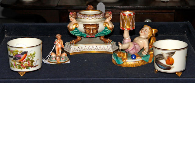 A Royal Worcester inkwell and cover, dated 1862, a Royal Worcester 'Boy with Drum' taperstick, circa 1870, a moon vase, dated 1874 and two posy vases, dated 1883