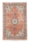 A silk Ghom carpet, Central Persia, 305cm x 199cm