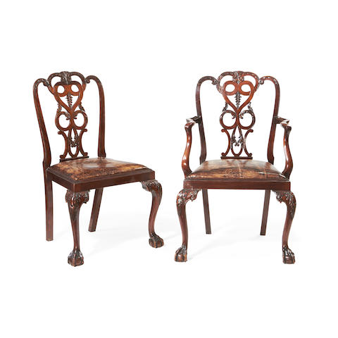 A set of eight Edwardian walnut dining chairs in the George II style