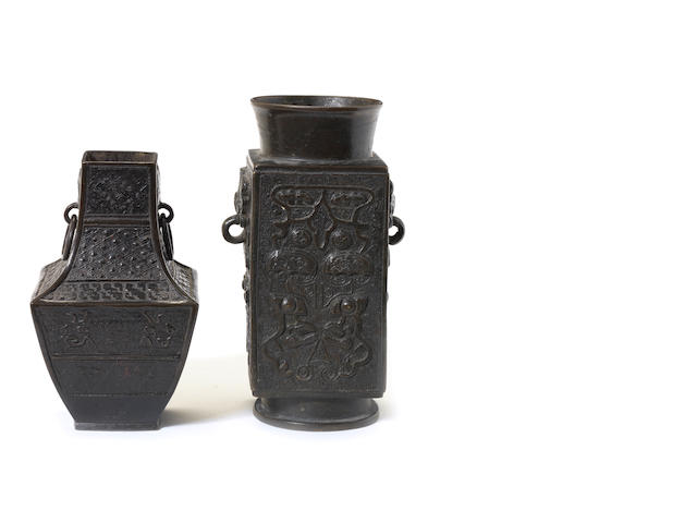 Two small bronze, or other metal, vases