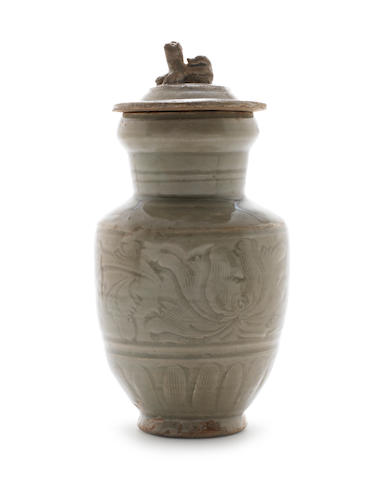 A celadon urn and cover