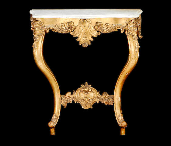 A late 19th century giltwood and composition serpentine console table