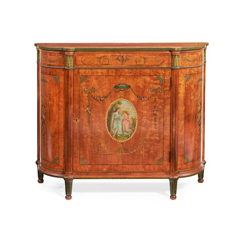 A late Victorian satinwood and polychrome decorated side cabinet in the Sheraton revival style