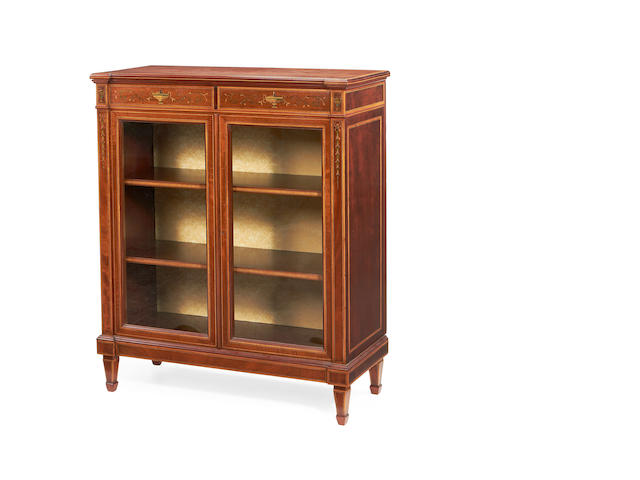 A late Victorian fiddleback mahogany, satinwood banded and stained sycamore marquetry low bookcase by Maple & Co.
