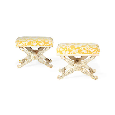 A pair of early 20th century white painted tabourets in the Italian Empire style