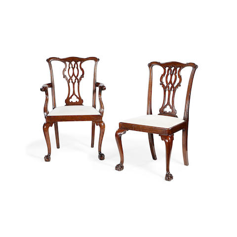 A set of eight late 19th/early 20th century mahogany dining chairs in the George III Chippendale style