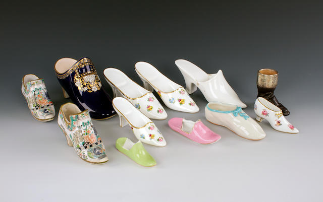A collection of various porcelain and earthenware shoes and slippers, 20th century
