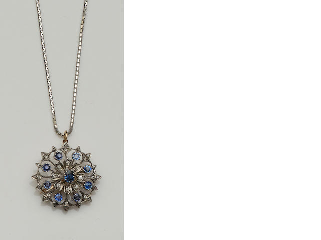 A sapphire and diamond floral brooch/pendant